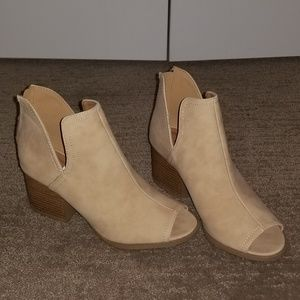 NWT, Slip on booties very light tan color.